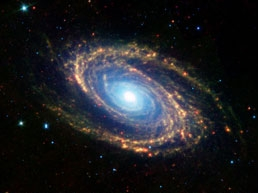 Dusty, starry arms of spiral galaxy M81 via the Spitzer Space Telescope (SIRTF)