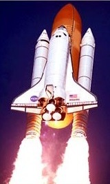 NASA photo of a space shuttle flying upward
